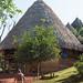 Embera medicine man and hut