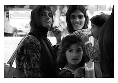 at the chai stand (handheld-films) Tags: india street portrait portraiture people women group mono blackandwhite indian subcontinent chai girl female eyes