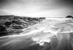 Incoming (Simon Rich Photography) Tags: bude beach cornwall atlantic ocean tide waves longexposure water movement rocks jurassic tode wet sky clouds landscape seascape simonrich simonrichphotography mrmonts canon