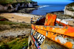 'Springflower' - abandoned fishing boat, North Landing, Flamborough, North Yorkshire (Powderpuff GP) Tags: northyorkshire abandoned text colourful depthoffield perspective orange holidays cliffs beach seaside flamborough boat fishingboat