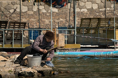 Laundry along the River (virtualwayfarer) Tags: guilinshi guangxizhuangzuzizhiqu china cn guilin river rivertrip bambooraft rafttrip yangshuocounty yangshuo county laundry woman oldwoman chores dailychores beautifulchina chinese guangxi karst rockformations chinatrip rockformation sonyalpha a7rii travelblog travelblogger virtualwayfarer alexberger asia southeastasia asian