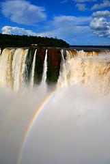 Iguazu Falls (makingacross) Tags: nikon d3000 iguazu falls iguacu argentina waterfall water spray sky blue clouds rainbow