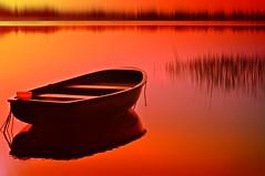 silence... (Eggii) Tags: sunset calm silence time orange red evening lake boat