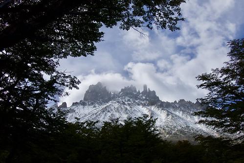 chile-patagonia-aysen-cerro-castillo-view-through-trees-to-peaks