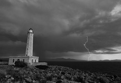 The lighthouse. (tzevang.com) Tags: seascape bw stormy lighthouse sea greece lakonia gythio thunderstorms