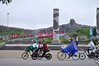 STUDENT OUTING (Roving I) Tags: students bikes bicycles motorscooters rainwear memorials monuments mothers tamky vietnam