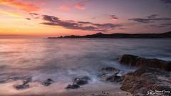 La Marinedda sunset (stewartl2010) Tags: calm longexposure rocks beach clouds sunset sky granite bay colorefexpro4 italy nikfilters dusk isolarossa lamarinedda sardinia
