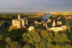 Evening light over Warkworth Castle and the River Coquet (iancowe) Tags: warkworth castle warkworthcastle northumbria northumberland england english dji phantom 4 pro drone aerial sunset amble rivercoquet evening northeast englishheritage hilltop