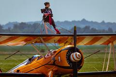 Limbering up (aquanout) Tags: aeroplane plane aircraft airplane people orange biplane