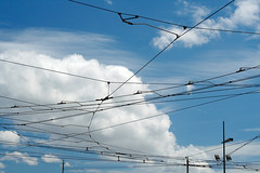 Wired (H&T PhotoWalks) Tags: overheadline overheadwire tram publictransport sky blue white clouds abstract object lisboa lisbon portugal canoneos350d canon28135 powerlines ix