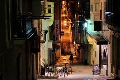 Malta Streets (Douguerreotype) Tags: lights city dark night buildings people street malta silhouette valletta architecture urban sign