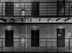 prison inside -explore- (MAICN) Tags: 2018 lines türen vhs building leeuwarden mono linien sw bw blackwhite monochrome geometrisch architecture schwarzweis doors gefängnis architektur einfarbig prison geometry gebäude