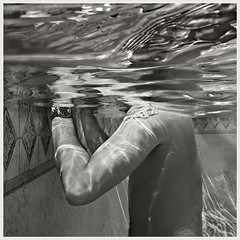 Pool #5 B&W 2018; No Head &, No Shoulders (hamsiksa) Tags: water reflections refractions surface ripples waves people swimmer swimmers swimming floating blackwhite backyardpools poolculture suburbia florida volusiacounty deland man male figure peopleunderwater abstraction fragmentation abstract