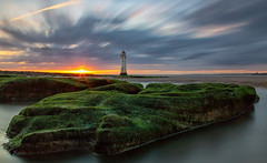 Costa del Wallasey (gmorriswk) Tags: wallasey england unitedkingdom gb sunset long exposure new brighton lighthouse clouds cloudscape seascape landscape river mersey rocks fort perch rock