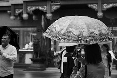 smart secrets (murtica27) Tags: china shanghai prc people street strase scenery east monochrome bw sw schwarz weis black white umbrella menschen leute man public schirm girl chinese tradition smartphone sony alpha murtica