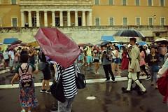 Α Raining Summer  Day : Confusion (Storyteller.....) Tags: athens summer rain rainind people confusion tourists running guard monument photograph umprellas