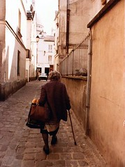 Old Woman with Baugettes in Montmatre Street, Paris 1984 - by bfraz
