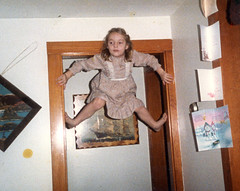 climbing the doorway again (pixietart) Tags: me vintage 1984 climbing door monkey gymnast hyperactive firestarter