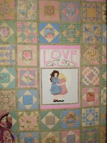 The center applique block is one of Sue Garman's patterns - I think maybe it