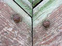 Old iron nails in an old wooden door (Gerlinde Hofmann) Tags: door two brown green metal germany wooden iron paint nail thuringia peelingpaint hildburghausen abblätterndefarbe madeofwood zweigegenstände zweidinge ausholzgemacht holzgegenstand