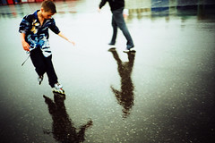 wet promenade #1 (lomokev) Tags: england reflection wet rain weather children lomo lca xpro lomography crossprocessed xprocess brighton child 100v10f lomolca promenade rollerblade agfa jessops100asaslidefilm agfaprecisa lomograph agfaprecisa100 cruzando precisa jessopsslidefilm rollablading file:name=cd00724