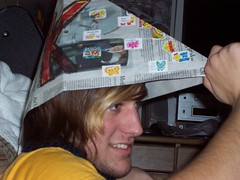 Putting on the hat (BrightlyWounded) Tags: dusty emo paper captain happy smile
