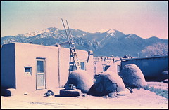 taos pueblo. taos, nm. 1999. (eyetwist) Tags: newmexico southwest film graveyard xpro crossprocessed ruins cross desert crossprocess aviation indian headstone pueblo 1999 ishootfilm adobe chemistry transparency marker positive taos process processed e6 indigenous emulsion c41 vps betterlivingthroughchemistry c41toe6 c41e6 eyetwist betterlivingthruchemistry negativetoslide contactforstockusage thisimagemaybeavailableforlicensecontactformoreinfo xproc41toe6 xproneg2pos