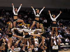 Cheerleader Pyramid (freshasspearmint) Tags: 2005 girls sports basketball cheerleaders pyramid crowd guys uniforms bleachers vcu midriff siegelcenter
