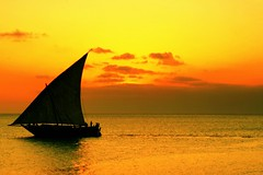 a picture of a sailing boat during sunset