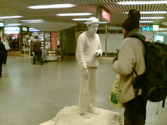 Human statue at the railway station (mpolla) Tags: cameraphone helsinki humanstatue