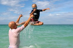 B goes up (lucy96734) Tags: family b fun dad child splash noseplug lanikaibeach throwyourkidsintheair experience12
