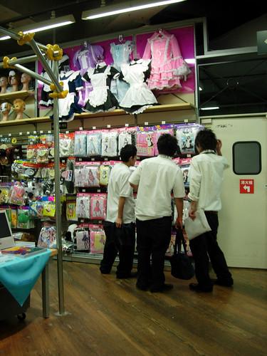 Boys looking at maid uniforms