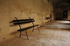 Cloister in Saint-Remy (yousef_anani) Tags: france chairs nikond70 tranquility madness cloister provence benches vangogh sanctuary sanity sanremy ourworld2006