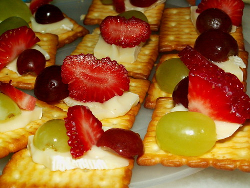 Fresh fruits with cream cheese on crackers