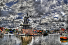 Windmill on a Cloudy Canal (Stuck in Customs) Tags: holland haarlem netherlands windmill clouds nikon wind d2x hdr d2xs