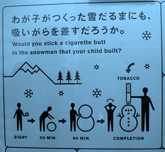 Would you stick a cigarette butt in the snowman that your child built? (Ch@rTy) Tags: travel silly strange japan advertising fun weird lies smoking adventure odd charlie health smoker confusion nicotine jti jetprogramme tyack charlietyackcom