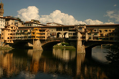 Ponte Vecchio (Kathy~) Tags: bridge vacation italy white reflection building water yellow tag3 taggedout clouds wow river geotagged florence interestingness europe tag2 tag1 tag awesome super 2006 september explore kathy cw rower helluva brillant interestingness30 i500 missedthe aplusphoto kathy~ superhearts photofaceoffwinner pfogold pfosilver challengew herowinner