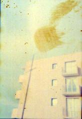 la mancha [analog] (alvazer) Tags: building film facade digital plane 35mm print angle finger edificio negative fachada fingerprint lamancha franka mancha huella huelladigital huelladactilar dactilar alvazer vazer