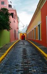 Callejón Colorido (kotobuki711) Tags: street pink blue sky orange color green yellow clouds alley colorful oldsanjuan puertorico vivid explore walkway abigfave