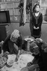 Dumplings For Dinner (peterkelly) Tags: bw digital canon 6d asia tajikistan gadventures centralasiaadventurealmatytotashkent sarytag home house cookingclass scarf women dumplings bucket girl