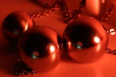 Metallic necklace #Circles (ryorii) Tags: circles macromondays metalic metallic necklace reflection flower daisy red light bokeh ball round rounded canon