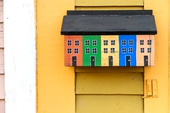 Rowhouse Mailbox (Karen_Chappell) Tags: house mail post mailbox yellow building architecture jellybeanrow stjohns city urba downtown multicoloured colourful colours colour color wood wooden paint painted clapboard orange green blue black white trim art
