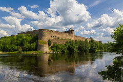 Ivangorod (kirill3.14) Tags: estonia russia border reflection outdoor town clouds trees ivangorod narva fortress river sky bikes water summer frontier castle greatphotographers