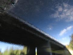 Bridge to Crap (andressolo) Tags: reflections reflection reflected reflect reflejo reflejos ripples river río water bridge bridges puente distortion distortions distorted agua