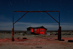 homestead. mojave desert, ca. 2018. by eyetwist - 2min exposure under full moon, 7x 2min exposures stacked for star trails. light painting with protomachines LED flashlight. nikon D7000 + nikkor 10-24mm.