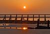 Sun in the water (Geoff Henson) Tags: dawn sunrise daybreak sunset sea ocean water tidebreak reflection sun boat beach sand pool 1000v40f