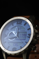 light (PHOTOGRAPHYSUAT) Tags: watch glass blue metal shiny braun light lighting reflection nikon 100mm blure