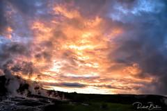 When sky burns at Geysir (Robert Bentia) Tags: sunset iceland colours geysir crazy red yellow steam grass green landscape nature natgeo blue water