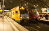 ODEG-operated RE2 trains makes a station stop while a DB-operated RE service departs on the next track (Glenn Courtney) Tags: berlin odeg re2 germany hauptbahnhof night passenger railroad railway station train