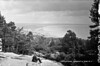 Where the mountains of Mourne sweep down to the sea! (National Library of Ireland on The Commons) Tags: robertfrench williamlawrence lawrencecollection lawrencephotographicstudio thelawrencephotographcollection glassnegative nationallibraryofireland slievedonard newcastle codown ireland northernireland ulster bay mountain sea man percyfrench cap reading viewpoint lookout countydown donard
